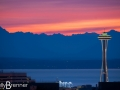 Sunset over the Space Needle and Olympic Mountains